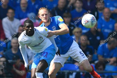 Matthew Clarke of Portsmouth and Amadou Bakayoko of Coventry City vie for the ball during Portsmouth vs Coventry City, Sky Bet EFL League 1 Football at Fratton Park on 22nd April 2019