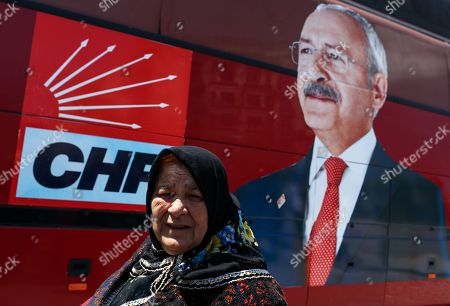 A supporter of main opposition Republican People's Party (CHP) walks in front of the picture of Turkey's main opposition Republican People's Party (CHP) leader Kemal Kilicdaroglu during a rally protesting the attack against Kilicdaroglu a day earlier, in Istanbul, Turkey, 22 April 2019. A group of people on 21 April attacked Kemal Kilicdaroglu before he was secured by police officers and guards during a soldier funeral in Cubuk district near Ankara.