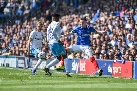 Portsmouth Midfielder, Ronan Curtis (11) beats Coventry City Defender, Dujon Sterling (17) to the ball during the EFL Sky Bet League 1 match between Portsmouth and Coventry City at Fratton Park, Portsmouth
