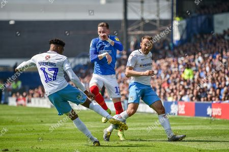 Coventry City Defender, Dujon Sterling (17) and Portsmouth Midfielder, Ronan Curtis (11) challenge fro the ball during the EFL Sky Bet League 1 match between Portsmouth and Coventry City at Fratton Park, Portsmouth