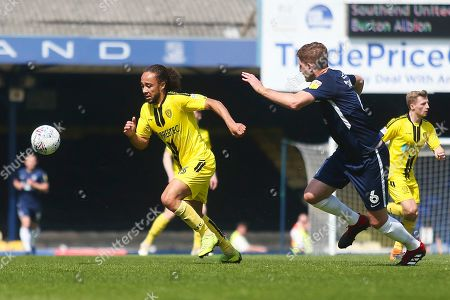 Burton Albion midfielder Marcus Harness (16) attacks against Southend United defender Michael Turner (6) during the EFL Sky Bet League 1 match between Southend United and Burton Albion at Roots Hall, Southend