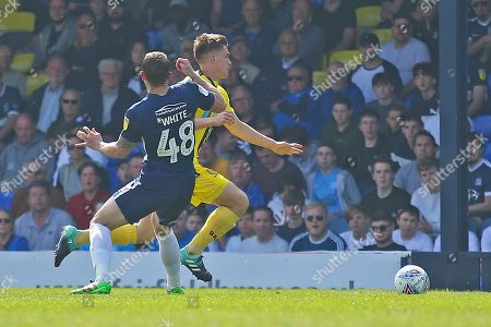 Burton Albion midfielder Ben Fox (12) goes past Southend United defender John White (48) during the EFL Sky Bet League 1 match between Southend United and Burton Albion at Roots Hall, Southend