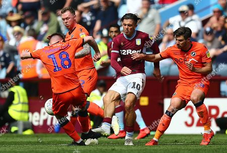 Jack Grealish of Aston Villa  battles with  Ryan Leonard of Millwall and  Aiden O'Brien of Millwall