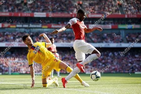 Ainsley Maitland-Niles of Arsenal gets away from Joel Ward of Crystal Palace