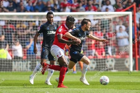 Pele (28) challenges Jonathan Howson (16) during the EFL Sky Bet Championship match between Nottingham Forest and Middlesbrough at the City Ground, Nottingham