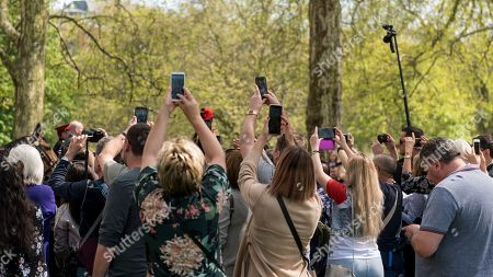 Members of the public try to take photos of Princess Anne departing after the King's Troop Royal Horse Artillery took part in a 41 gun salute in Hyde Park to mark the 93rd birthday of Her Majesty The Queen.