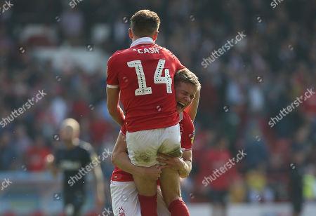 Nottingham Forest's Ryan Yates celebrates victory with Matty Cash