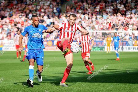 CAPTION CORRECTION Peterborough defender Rhys Bennett (16) and Sunderland forward Charlie Wyke the EFL Sky Bet League 1 match between Peterborough United and Sunderland at London Road, Peterborough