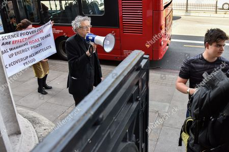 Stock Photo of Piers Corbyn (brother of Jeremy Corbyn) protesting against climate change activists as people queue to see climate change campaigner Greta Thurnberg.