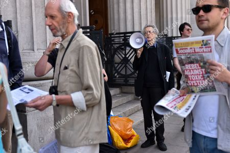 Stock Picture of Piers Corbyn (brother of Jeremy Corbyn) protesting against climate change activists as people queue to see climate change campaigner Greta Thurnberg.