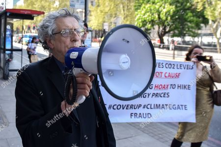 Editorial image of Piers Corbyn stages a protest against climate change activists outside the Greta Thurnberg speech venue, London, UK. - 22 Apr 2019.