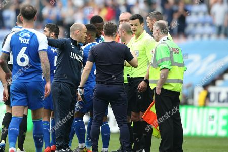Stock Image of Preston North End Manager Alex Neil has words with Referee Andrew Madley at the end of the game in the EFL Sky Bet Championship match between Wigan Athletic and Preston North End at the DW Stadium, Wigan