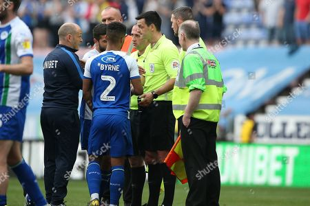 Preston North End Manager Alex Neil has words with Referee Andrew Madley at the end of the game in the EFL Sky Bet Championship match between Wigan Athletic and Preston North End at the DW Stadium, Wigan