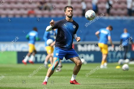 Wigan Athletic defender Danny Fox (6) warming up during the EFL Sky Bet Championship match between Wigan Athletic and Preston North End at the DW Stadium, Wigan