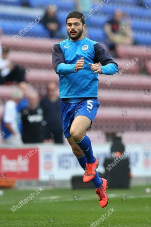 Wigan Athletic midfielder Sam Morsy (5) warming up during the EFL Sky Bet Championship match between Wigan Athletic and Preston North End at the DW Stadium, Wigan