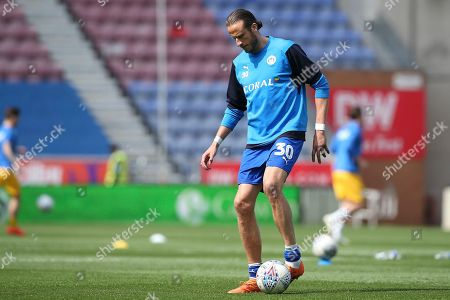 Stock Image of Wigan Athletic defender Jonas Olsson (30) warming up during the EFL Sky Bet Championship match between Wigan Athletic and Preston North End at the DW Stadium, Wigan