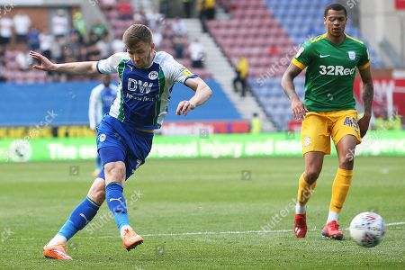 Wigan Athletic midfielder Lee Evans (36) scores a goal 2-0 during the EFL Sky Bet Championship match between Wigan Athletic and Preston North End at the DW Stadium, Wigan