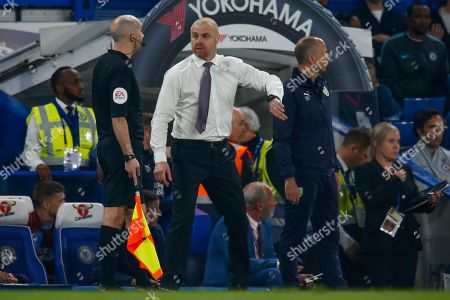 Burnley manager Sean Dyche suggests time is up to assistant referee Adrian Holmes during the Premier League match between Chelsea and Burnley at Stamford Bridge, London