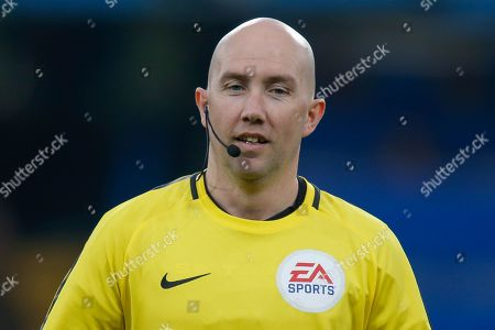 Stock Image of Assistant referee Adrian Holmes warming up before the Premier League match between Chelsea and Burnley at Stamford Bridge, London