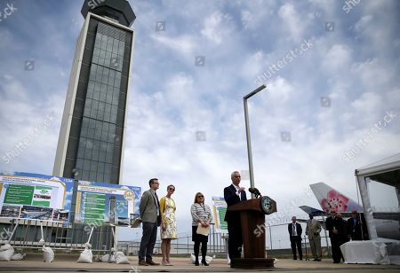 Mayor Rahm Emanuel speaks during a news conference outside the south air traffic control tower at O'Hare International Airport, in Chicago. The south control tower has been awarded gold status by a group that monitors standards for eco-friendly buildings. The tower is one of three that the FAA operates at O'Hare