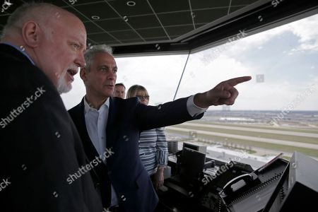 Mayor Rahm Emanuel, second from left, tours inside the south air traffic control tower at O'Hare International Airport, in Chicago. The south control tower has been awarded gold status by a group that monitors standards for eco-friendly buildings. The tower is one of three that the FAA operates at O'Hare