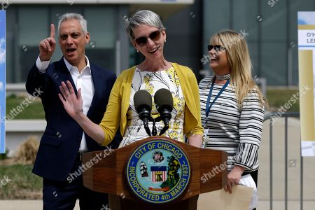 Chicago Mayor Rahm Emanuel, left, makes a comment as Rebecca MacPherson, FAA Great Lakes Regional Administrator, is introduced to speak during a news conference outside of the south air traffic control tower at O'Hare International Airport, in Chicago. The south control tower has been awarded gold status by a group that monitors standards for eco-friendly buildings. The tower is one of three that the FAA operates at O'Hare. At right is Chicago Department of Aviation Commissioner Jamie Rhee