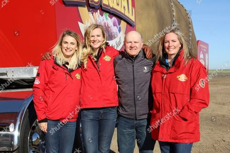 Stock Image of Idaho Potato Commission President & CEO Frank Muir, second from right, along with Tater Team Jessica Coulthard, Kaylee Wells, and driver Melissa Bradford on the grand opening day of the Big Idaho® Potato Hotel on in South Boise, Idaho. The unique dwelling, measuring 336 square feet, is available for rent on Airbnb