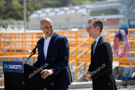 Cory Booker, Eric Garcetti. Democratic presidential candidate Sen. Cory Booker, left, and Los Angeles Mayor Eric Garcetti share a laugh while talking to reporters at the Hyperion Water Reclamation Plant, in the Playa del Rey section of Los Angeles