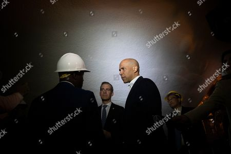 Cory Booker, Eric Garcetti. Democratic presidential candidate Sen. Cory Booker, center, and Los Angeles Mayor Eric Garcetti tour the Hyperion Water Reclamation Plant, in the Playa del Rey section of Los Angeles
