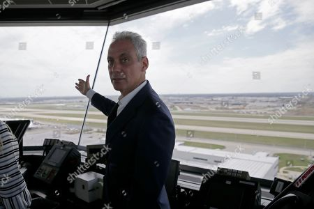 Chicago Mayor Rahm Emanuel tours inside the south air traffic control tower at O'Hare International Airport, in Chicago. The south control tower has been awarded gold status by a group that monitors standards for eco-friendly buildings. The tower is one of three that the FAA operates at O'Hare