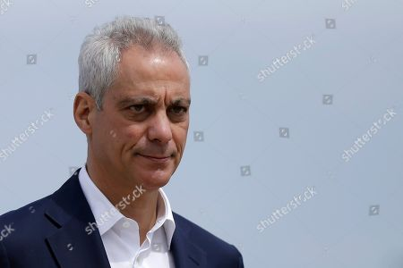 Chicago Mayor Rahm Emanuel waves as he arrives at a news conference outside of the south air traffic control tower at O'Hare International Airport in Chicago. The south control tower has been awarded gold status by a group that monitors standards for eco-friendly buildings. The tower is one of three that the FAA operates at O'Hare