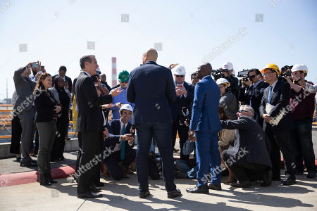 Cory Booker, Eric Garcetti. Democratic presidential candidate Sen. Cory Booker, center, and Los Angeles Mayor Eric Garcetti, left, are surrounded by the media during their visit to the Hyperion Water Reclamation Plant, in the Playa del Rey section of Los Angeles