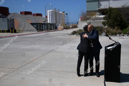 Cory Booker, Eric Garcetti. Democratic presidential candidate Sen. Cory Booker, right, hugs Los Angeles Mayor Eric Garcetti next to the podium during their visit to the Hyperion Water Reclamation Plant, in the Playa del Rey section of Los Angeles