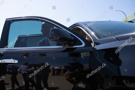 Democratic presidential candidate Sen. Cory Booker gets into an SUV after his visit to the Hyperion Water Reclamation Plant, in the Playa del Rey section of Los Angeles
