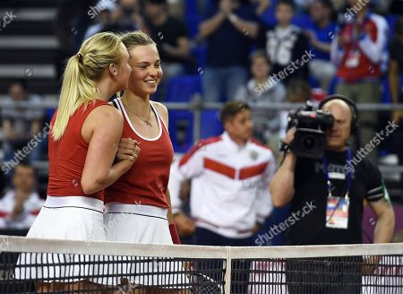 Russian tennis player Anastasia Potapova (left) and Vlada Koval (right) during a doubles match against Italian tennis players Jasmine Paolini and Sara Errani