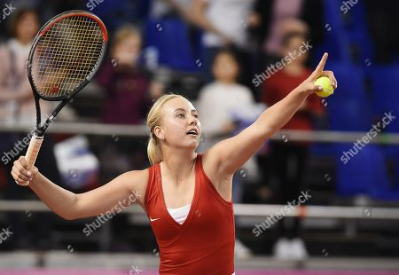 The playoffs of the World Group II Fed Cup between the women's teams of Russia and Italy and the gymnastics complex CSKA. Russian tennis player Anastasia Potapova during a doubles match with Vlada Koval against Italian tennis players Jasmine Paolini and Sara Errani