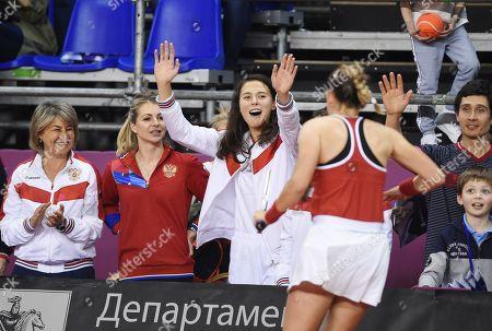 Russian tennis player Natalya Vikhlyantseva (center) after a doubles match with Russian tennis players Anastasia Potapova and Vlada Koval with Italian tennis players Jasmine Paolini and Sara Errani
