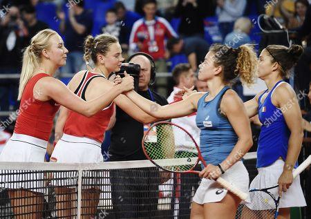 Russian tennis players Anastasia Potapova, Vlada Koval, Italian tennis players Jasmine Paolini and Sara Errani after a doubles match