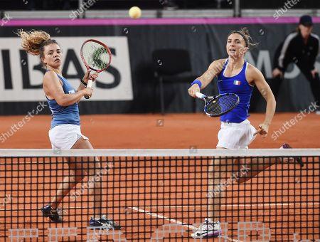 Italian tennis players Sara Errani and Jasmine Paolini (left) during a doubles match Russian tennis players Vlada Koval and Anastasia Potapova
