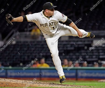 Pittsburgh Pirates outfielder JB Shuck delivers in the ninth inning of a baseball game against the Arizona Diamondbacks in Pittsburgh