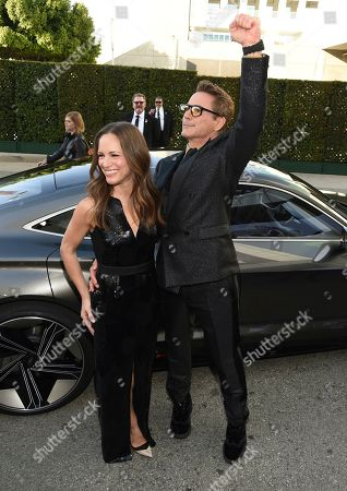 """Susan Downey, Robert Downey Jr. Susan Downey, left, and Robert Downey Jr. arrive at the premiere of """"Avengers: Endgame"""" at the Los Angeles Convention Center on"""