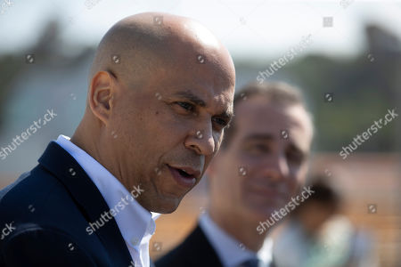 Democratic presidential candidate Sen. Cory Booker talks to reporters during his visit to the Hyperion Water Reclamation Plant, in the Playa del Rey section of Los Angeles