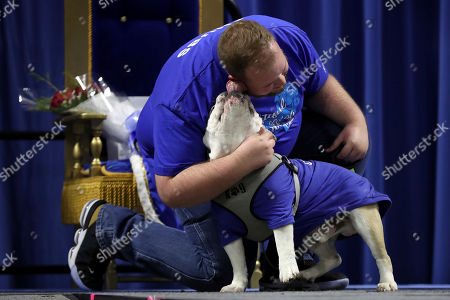 Richard Butler, of Des Moines, Iowa, gets a kiss from his dog Chubs during the 40th annual Drake Relays Beautiful Bulldog Contest, in Des Moines, Iowa. The pageant kicks off the Drake Relays festivities at Drake University where a bulldog is the mascot