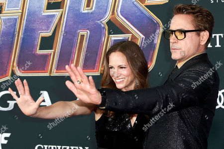 Robert Downey Jr. (R) and Susan Downey (L) pose for the photographers upon their arrival for the premiere of 'Avengers: Endgame' at the LA Convention Center in Los Angeles, California, USA, 22 April 2019. 'Avengers: Endgame' will be released US theaters on 26 April.