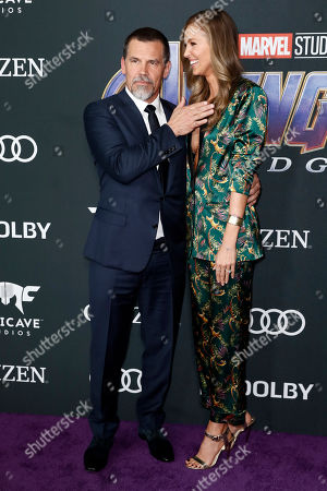 Josh Brolin (L) and his wife US model Kathryn Boyd (R) pose for photographers upon their arrival for the premiere of 'Avengers: Endgame' at the LA Convention Center in Los Angeles, California, USA, 22 April 2019. 'Avengers: Endgame' will be released US theaters on 26 April.