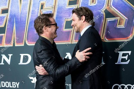 Bradley Cooper and Robert Downey Jr. interact upon their arrival for the premiere of 'Avengers: Endgame' at the LA Convention Center in Los Angeles, California, USA, 22 April 2019. 'Avengers: Endgame' will be released in US theater on April 26.