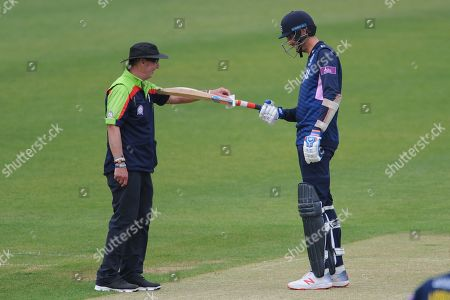 Steven Finn of Middlesex has his bat measured by umpire Jeremy Lloyds during the Royal London One Day Cup match between Hampshire County Cricket Club and Middlesex County Cricket Club at the Ageas Bowl, Southampton