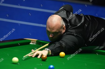 Stock Photo of Stuart Bingham of England at the table during his first round match
