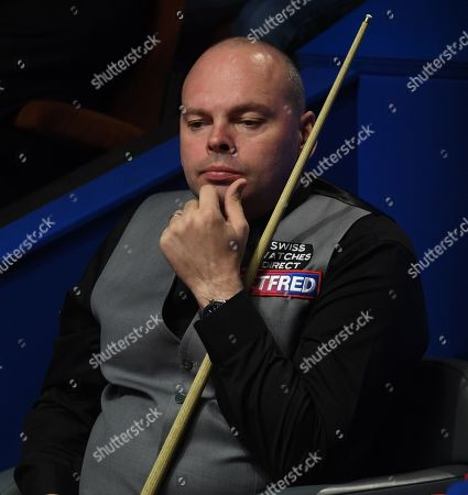 Stock Picture of Stuart Bingham of England sits in his chair during his first round match
