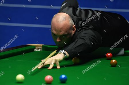 Stuart Bingham of England at the table during his first round match